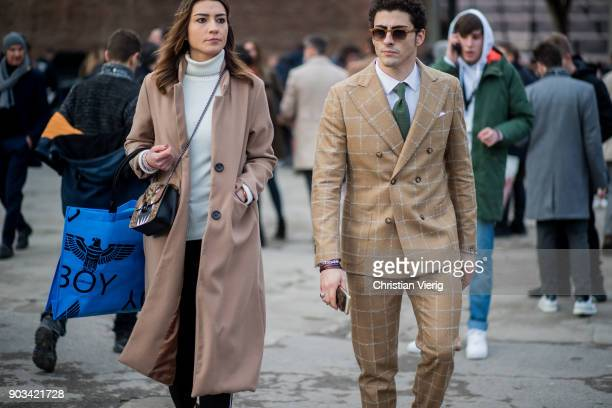 Guests wearing wool coat beige suit is seen during the 93 Pitti Immagine Uomo at Fortezza Da Basso on January 10 2018 in Florence Italy