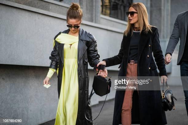 Guests wearing yellow dress black leather coat seen during MercedesBenz Tbilisi Fashion Week on November 5 2018 in Tbilisi Georgia