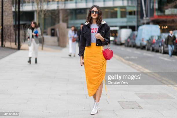 Guests wearing yellow skirt heart bag outside Topshop Unique on day 3 of the London Fashion Week February 2017 collections on February 19 2017 in...