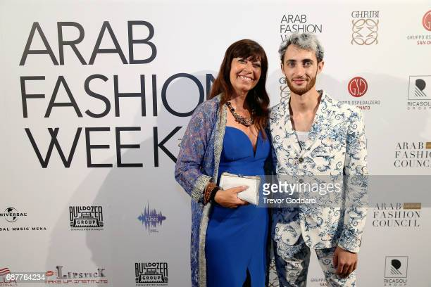 Guests with Jacob Abrian pose at the Arab Fashion Week Ready Couture Resort 2018 Gala Dinner on May 202017 at Armani Hotel in Dubai United Arab...