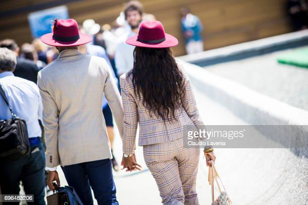 Guests with Maroon hat are seen during Pitti Immagine Uomo 92 at Fortezza Da Basso on June 15 2017 in Florence Italy