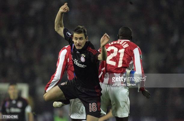 Gueye Ibrahima of Belgrade and Miroslav Klose of Bayern action during the UEFA Cup group F match between Crvena Zvezda and Bayern Munich at Crvena...