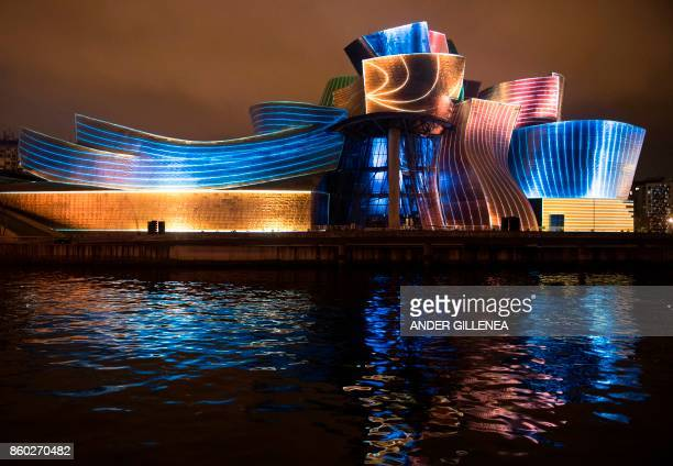 Guggenheim Bilbao Museum is illuminated with the 'Reflections' mapping projection by the video design company 59 Productions during the celebrations...