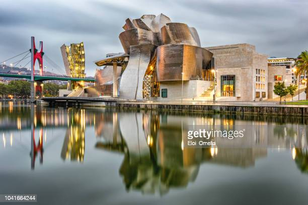 guggenheim bilbao museum reflection in the morning - spain stock pictures, royalty-free photos & images
