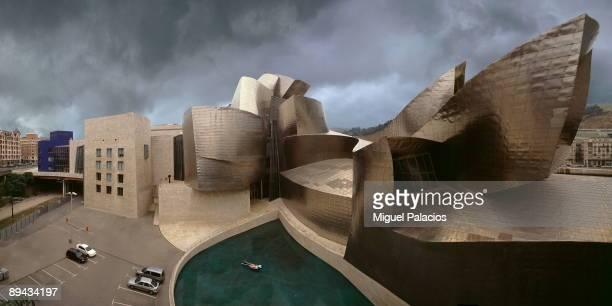 Guggenheim Museum and swimmer Bilbao Basque County