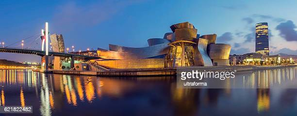 Guggenheim Museum Bilbao and Iberdrola Tower at dusk