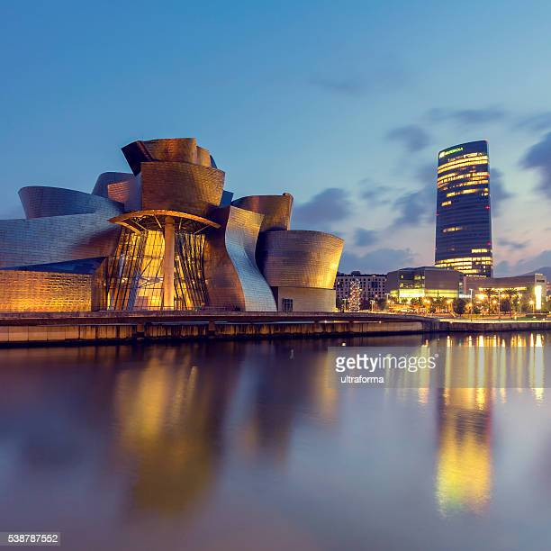guggenheim museum bilbao and iberdrola tower - bilbao stockfoto's en -beelden