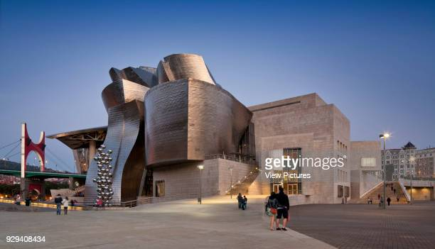 Guggenheim Museum Bilbao Bilbao Spain Architect Frank Gehry 1997 General view of riverside elevation at dusk
