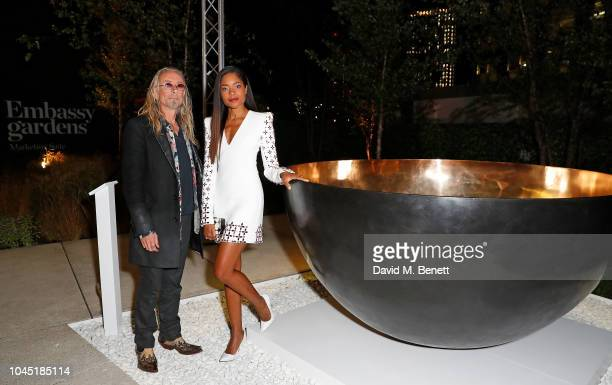 Guggi and Naomie Harris attend the unveiling of new Guggi sculpture at Embassy Gardens hosted by Ballymore and Harper's Bazaar as part of Bazaar Art...