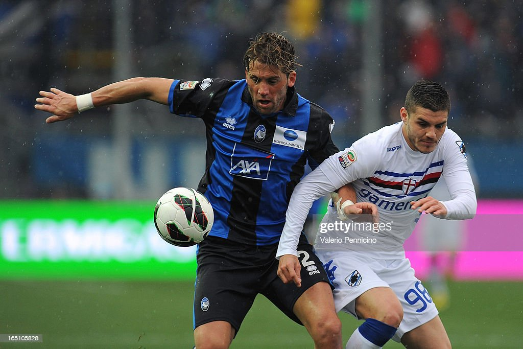 Guglielmo Stendardo (L) of Atalanta BC competes with Mauro Emanuel Icardi of UC Sampdoria during the Serie A match between Atalanta BC and UC Sampdoria at Stadio Atleti Azzurri d'Italia on March 30, 2013 in Bergamo, Italy.
