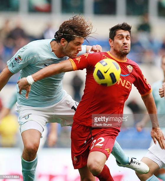Guglielmo Stendardo of SS Lazio competes for the ball with Marco Borriello of AS Roma during the Serie A match between SS Lazio and AS Roma at Stadio...