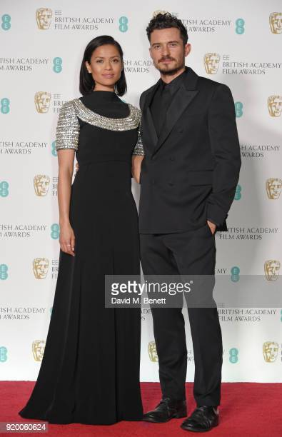 Gugu MbathaRaw and Orlando Bloom pose in the press room during the EE British Academy Film Awards held at Royal Albert Hall on February 18 2018 in...