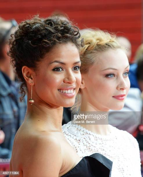 """Gugu Mbatha-Raw and Sarah Gadon attend the UK Premiere of """"Belle"""" at BFI Southbank on June 5, 2014 in London, England."""