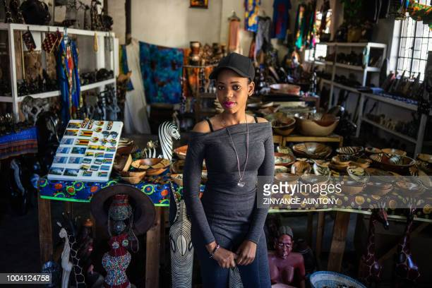 Gugulethu Ndlovu manager of a family business trading curios pose for a portrait on 28 June 2018 in the resort town of Victoria Falls After nearly...
