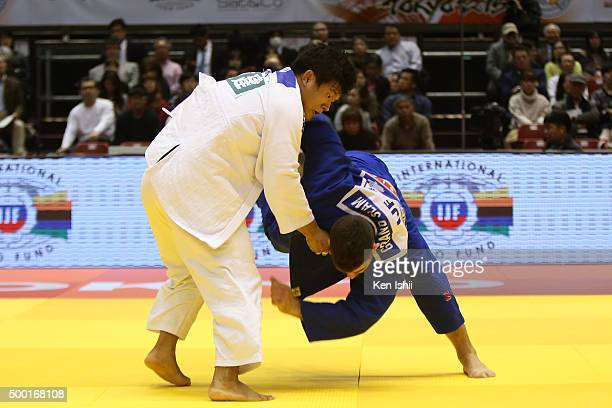 Guham Cho of Korea throws Cyrille Maret of France in the 100kg preliminary at Tokyo Metropolitan Gymnasium on December 6 2015 in Tokyo Japan