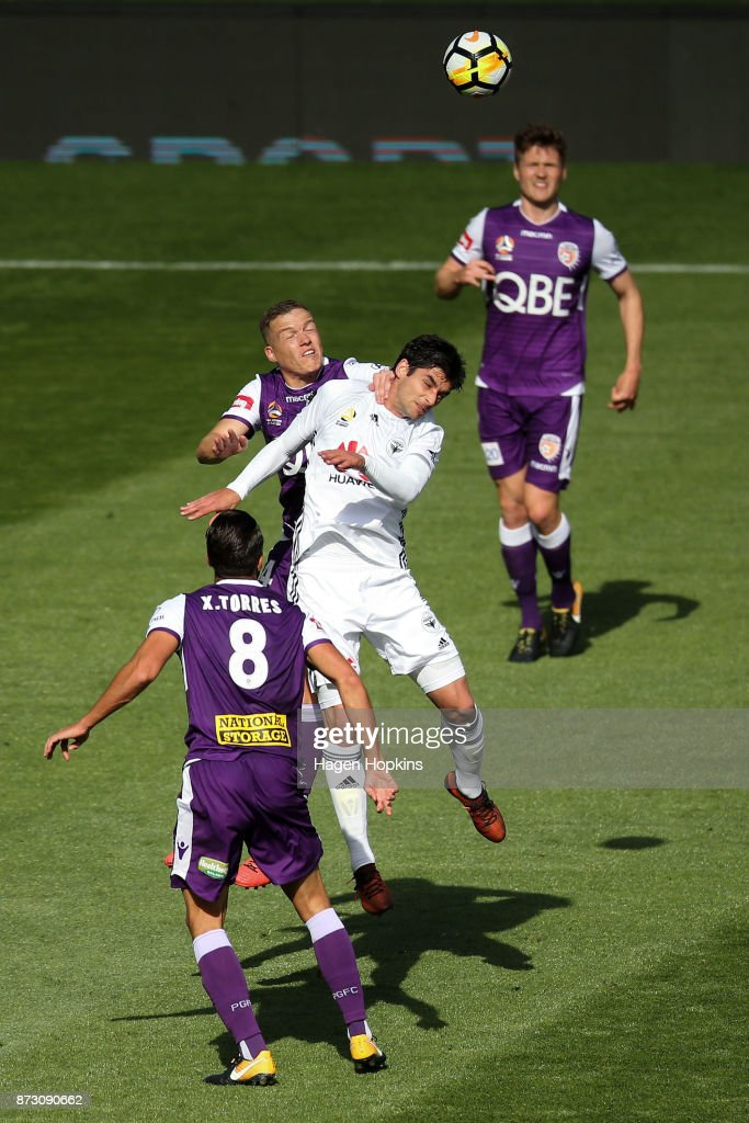 Gui Finkler of the Phoenix and Shane Lowry of the Glory compete for a header during the round six A-League match between the Wellington Phoenix and the Perth Glory at Westpac Stadium on November 12, 2017 in Wellington, New Zealand.