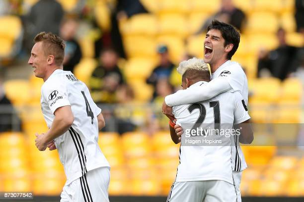 Gui Finkler of the Phoenix celebrates with Roy Krishna and Goran Paracki after scoring a goal during the round six ALeague match between the...
