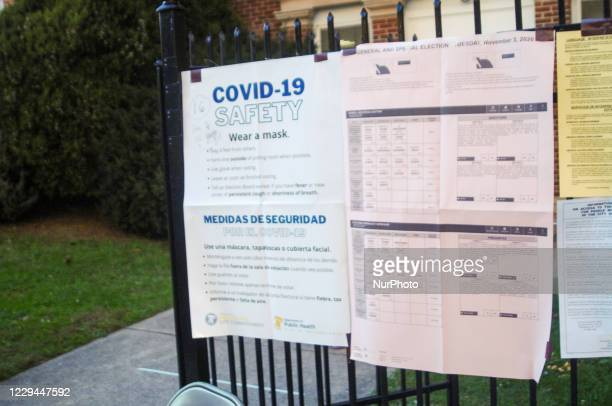 Guidance and ballot information are taped to a fence for voter convenience in Philadelphia, PA on November 3, 2020.