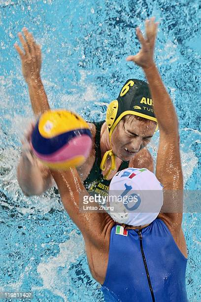 Guidasci giulia Rambaldi of Italy is challenged by Bronwen Knox of Australia in the Women's Water Polo first preliminary round match between Italy...