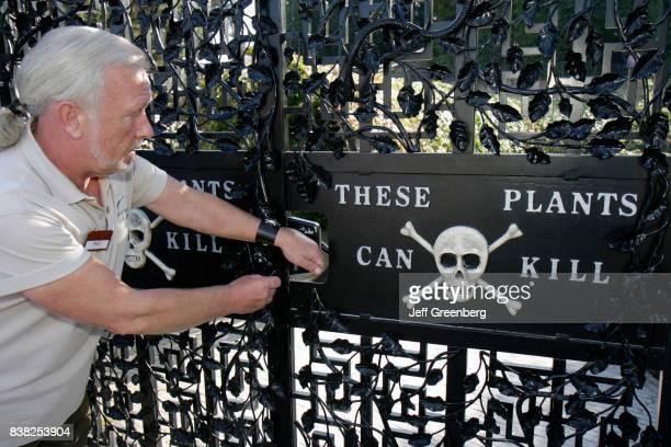 Guide at The Poison Garden gate at Alnwick Garden.