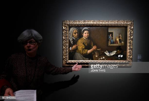 A guide gives explanations about the painting 'Christ in the house of Martha and Mary' by Spanish painter Diego Velezquez during a preview of the...