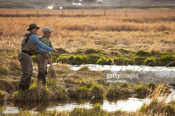 guide helps scout for fish - speckled trout stock photos and pictures