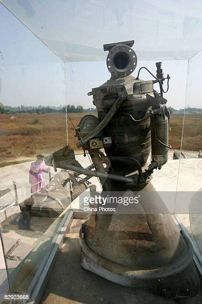 A guide in Mongolian costume introduces the carrier rocket for Shenzhou6 to the tourists at a scenic spot on September 20 2008 in Hohhot of the Inner...