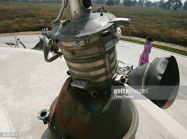 A guide in Mongolian costume introduces the roll booster for Shenzhou3 to the tourists at a scenic spot on September 20 2008 in Hohhot of the Inner...