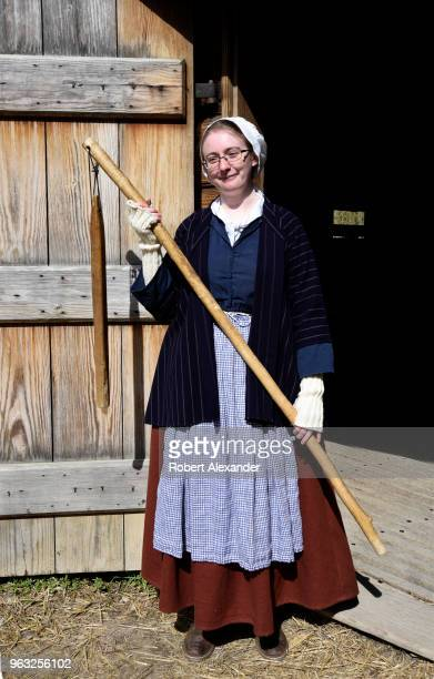 A guide in period constume stands at the entrance to the recreated 16sided barn at Mount Vernon the plantation owned by George Washington the first...