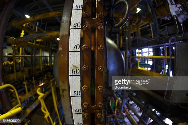 A guide indicates oil levels on the towel deck aboard the Casablanca oil platform operated by Repsol SA in the Mediterranean Sea off the coast of...