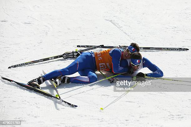 Guide Julien Bourla embraces Thomas Clarion of France as they celebrate winning the bronze in the men's 10km Visually Impaired crosscountry skiing on...