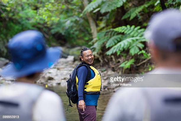 a guide leads two people on a jungle tour - wonderlust stock photos and pictures