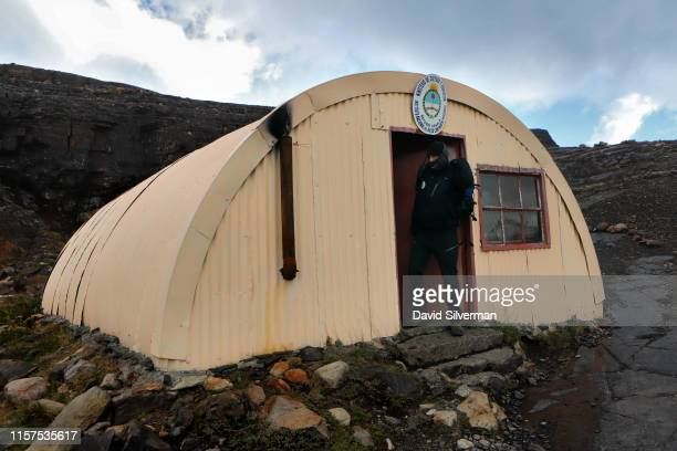 A guide leaves a glacial research station quonset hut near the Upsala glacier while leading tourists around the Estancia Cristina homestead on April...