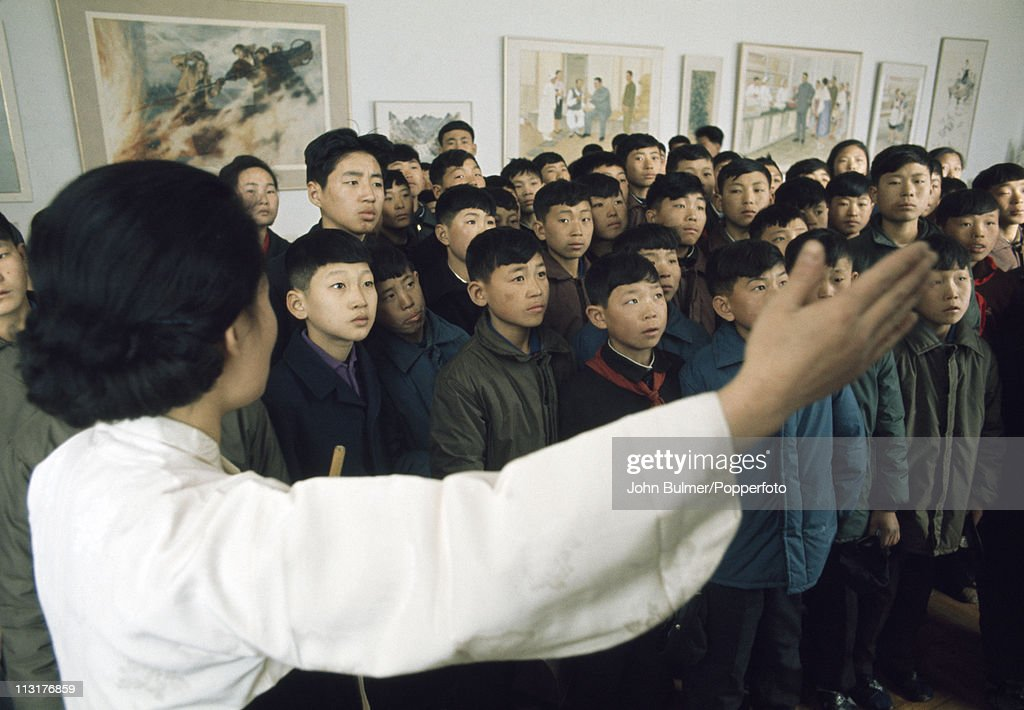 A guide shows a group of schoolchildren round a museum, North Korea, February 1973.