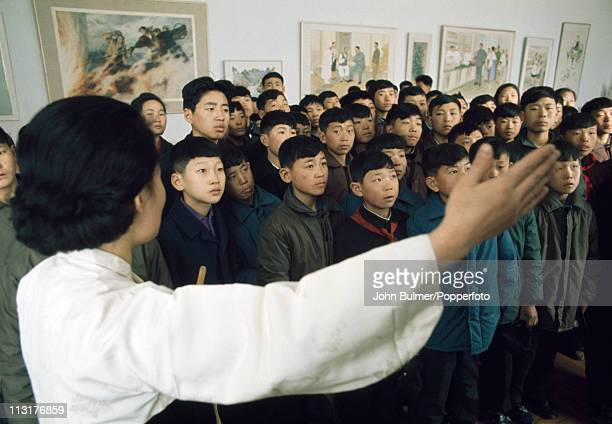 A guide shows a group of schoolchildren round a museum North Korea February 1973