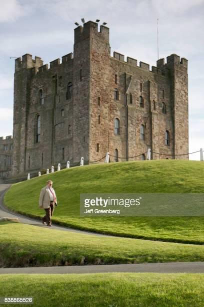 A guide walking outside Bamburgh Castle