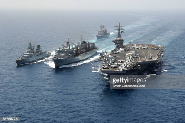 Guided-missile cruiser USS Hue City , the German navy frigate FGS Hamburd , the aircraft carrier USS Dwight D. Eisenhower , and the Military Sealift...