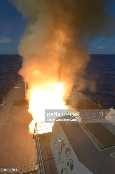 Guided-missile destroyer USS Michael Murphy fires a RIM-66M SM-2 missile, Pacific Ocean, 2013. Image courtesy US Navy. .
