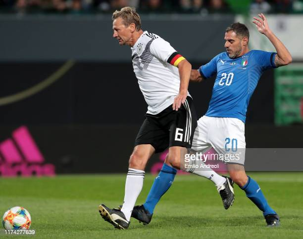 Guido Buchwald of DFB-All-Stars is challenged by Simone Perrotta of Azzurri Legends during the friendly match between DFB-All-Stars and Azzurri...