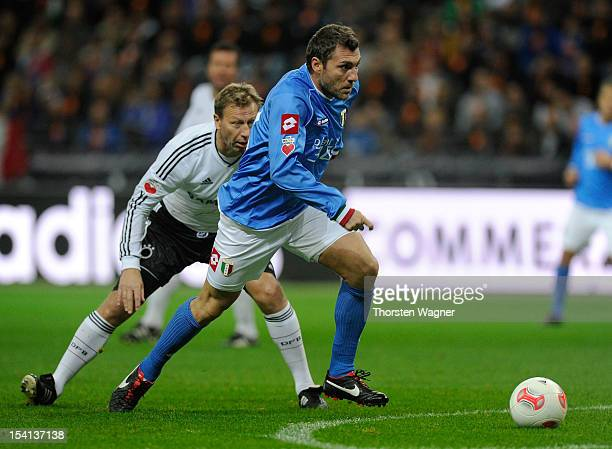 Guido Buchwald of Germany battles for the ball with Christian Vieri of Italy during the century match between Germany and Italy at Commerzbank Arena...
