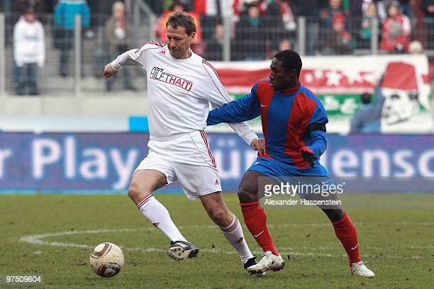 Guido Buchwald of the ran AllstarTeam battles for the ball with Jeff Lois of team Haiti during the charity match for earthquake victims in Haiti...