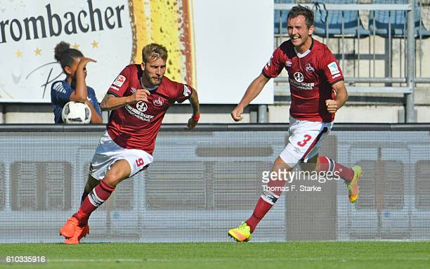 Guido Burgstaller and Even Hovland of Nuernberg celebrate their teams second goal during the Second Bundesliga match between DSC Arminia Bielefeld...