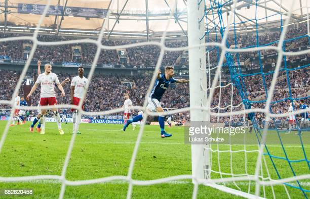 Guido Burgstaller celebrates his teams first goal during the Bundesliga match between FC Schalke 04 and Hamburger SV at VeltinsArena on May 13 2017...