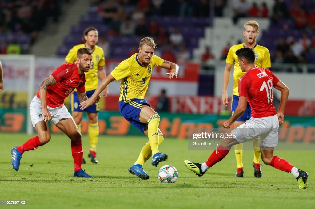 Guido Burgstaller of Austria, Robin Quaison of Sweden and Alessandro Schoepf of Austria during the International Friendship game between Austria and Sweden at the Generali Arena on September 06, 2018 in Vienna, Austria.
