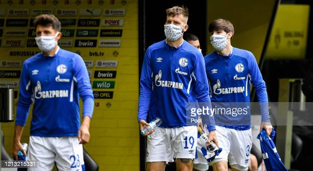 Guido Burgstaller of FC Schalke 04 arrives to the stadium with a face mask ahead of the Bundesliga match between Borussia Dortmund and FC Schalke 04...