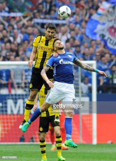 Guido Burgstaller of FC Schalke 04 in action against Sokratis Papastatopulos of Borussia Dortmund during the German Bundesliga soccer match between...