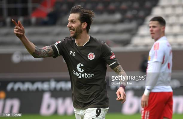 Guido Burgstaller of FC St. Pauli celebrates after scoring their side's first goal during the Second Bundesliga match between FC St. Pauli and SSV...