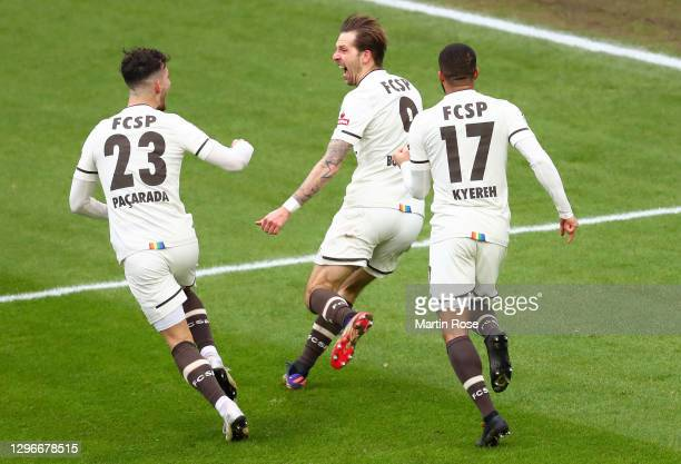 Guido Burgstaller of FC St. Pauli celebrates with teammates Leart Paqarada and Daniel-Kofi Kyereh after scoring his team's second goal during the...