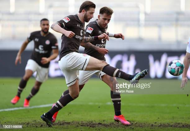Guido Burgstaller of FC St. Pauli scores his team's first goal during the Second Bundesliga match between FC St. Pauli and SV Darmstadt 98 at...