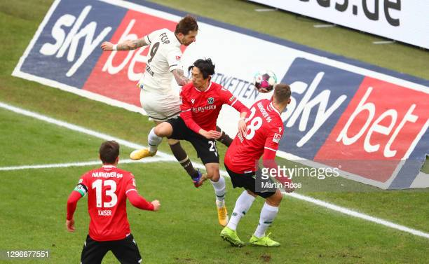 Guido Burgstaller of FC St. Pauli scores his team's second goal during the Second Bundesliga match between Hannover 96 and FC St. Pauli at HDI-Arena...